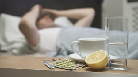 febre : Illness concept. Sick man with fever lying in the bed. Stock Footage