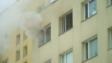 firemen : The fire in the apartment building.