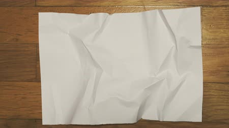 ezilmiş : Crumpled piece of white paper. Stop motion animation.