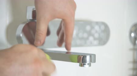 dezenfekte etmek : House cleaning. Man cleaning tap in bathroom. Stok Video