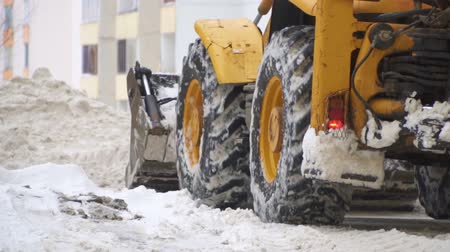 snow plow : Tractor shoveling snow on the street. Slow-motion. Stock Footage