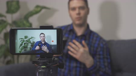 videocamera : Man making video blog about photo camera lenses. Stock Footage