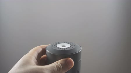 ferahlatıcı : Mans hand turning on electric air humidifier.