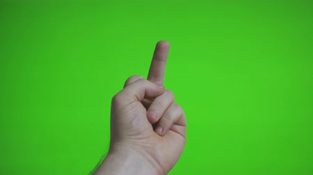 агрессивный : Male hand shows middle finger. Chroma key. Place for your advertisement.