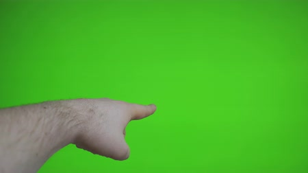forefinger : Male hand pointing to something. Chroma key. Place for your advertisement.