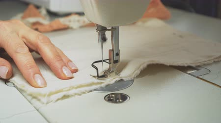рукоделие : Woman tailor working on sewing machine. Tailoring process.