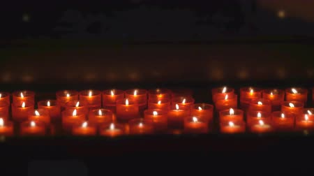 Burning candles on altar in church.
