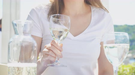 Woman is drinking glass of white wine Stock Footage
