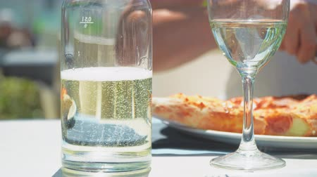 Woman eating pizza in restaurant at summer time. Stock Footage