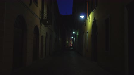 Illuminated lonely street at night.