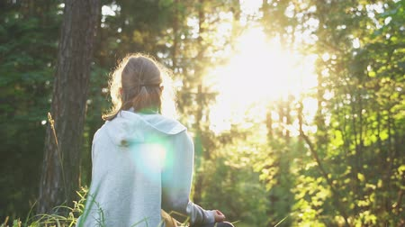 energy balance : Little girl relaxing in the forest in summertime. Stock Footage