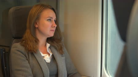 first class : Woman traveling by train and looking thru the window. Stock Footage
