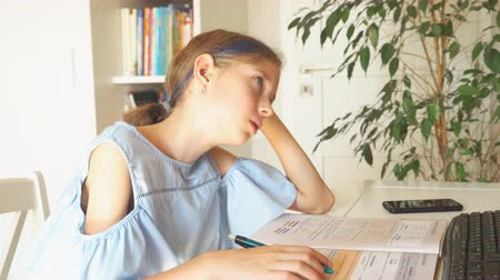 diligence : Little girl dont want to do her homework. Stock Footage