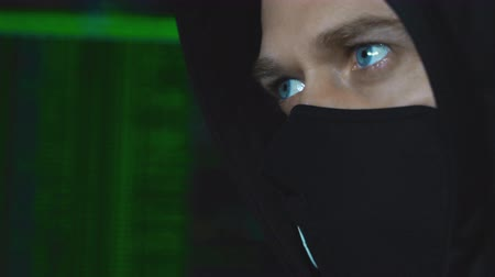 balaclava : Hacker in black mask. Hacking and internet security concept.