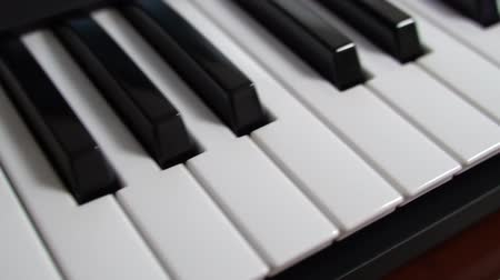 skladatel : Professional midi keyboard synthesizer. Close-up view.