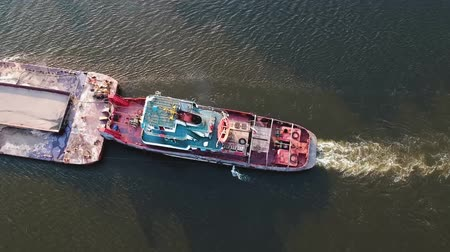 tow : Cargo ship on the river view from the height of the quadcopter Stock Footage