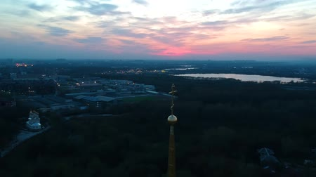 snowcapped : Flying around the dome with the cross of the orthodox church on the background of sunset