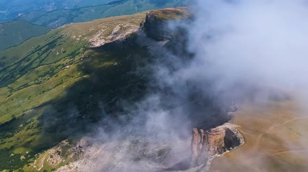 плато : View of the plateau Bermamyt from a height through the clouds on a summer day