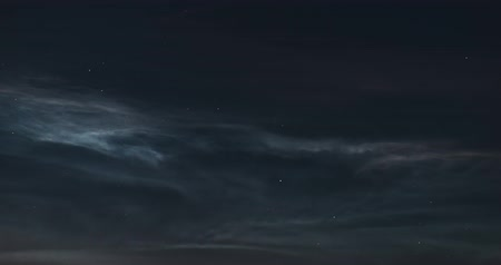 silvery : Timelapse of floating silvery clouds in the night sky