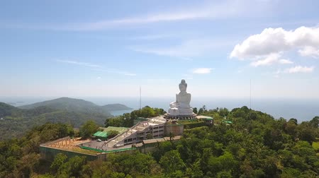 budha : Phuket Big Buddha 45 Meter Tall White Marble Statue on the Mountain. HD Aerial shot. Thailand.