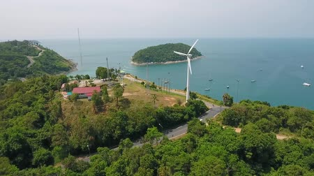 vento : Wind Power Station. Windmill near Naiharn beach, Phuket. HD. Aerial drone fly away slowmotion shot. Thailand. Vídeos