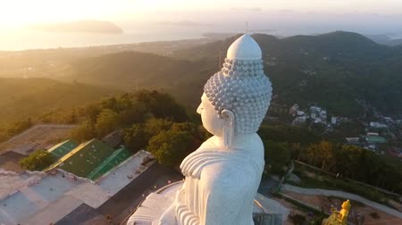 templom : Beautiful Golden Sunrise at White Big Buddha Statue Temple. HD Aerial View. Phuket, Thailand.