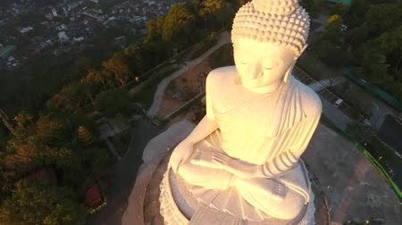 budha : White Big Buddha Statue During Sunrise Birds Eye View. HD Aerial. Phuket, Thailand. Stock Footage