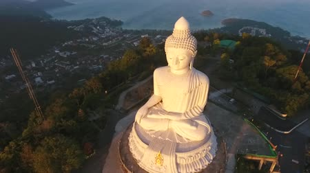 budha : Famous White Big Buddha Marble Statue. HD Aerial Fly Away View During Sunrise. Phuket, Thailand.