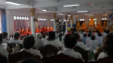 lineage : Phang Nga, Thailand - MAR 30 2017: People in White Dresses at Buddhist Ceremony in Temple with Monks.