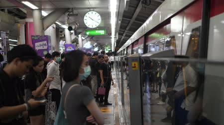 approaching subway : Bangkok, Thailand - 21 OCT 2017: People Waiting for Metro Train Doors to Open At Subway BTS Station. 4K. Stock Footage