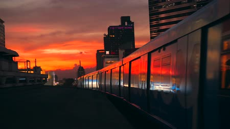 approaching subway : BTS Metro Subway Trains Leaving from the Station Siam with Skyscrappers and Beautiful Sunset Sky on Background. 4K, Timelapse. Bangkok, Thailand - 12 NOV 2017. Stock Footage
