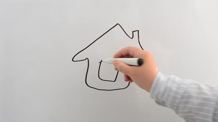 disposição : We draw a house on a board a marker