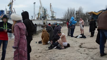 epiphany : BERDYANSK, UKRAINE - JANUARY 19: The orthodox holiday Epiphany at east Christians. Unknown people swim in the sea at air temperature below zero in Berdyansk, Ukraine on January 19, 2017