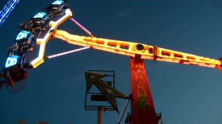 pursuit plane : Night attractions. Pendulum in the park. Shooting in the sea resort. Attraction of 360 degrees.