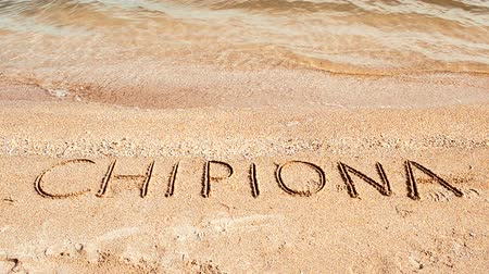 haziran : City Chipiona, inscription on sand. Spain.