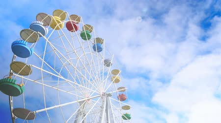 световой люк : Big wheel against clouds
