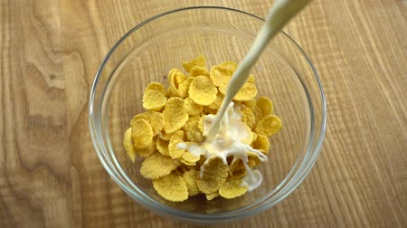 pouring : Corn flakes are filled with milk. Slow Motion.