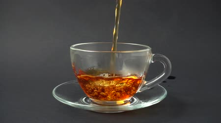 black tea : Tea is poured into the cup. Slow Motion. Stock Footage