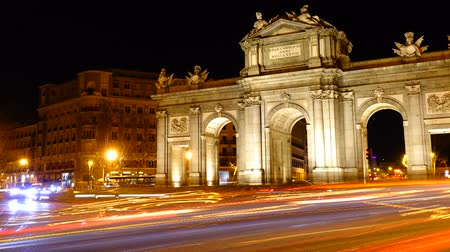plaza independencia : The Puerta de Alcala. Time lapse. Alcala Gate is a Neo-classical monument in the Plaza de la Independencia in Madrid.