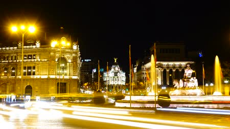 lion : Cibeles fountain in Madrid. Night traffic in Madrid. Timelapse.