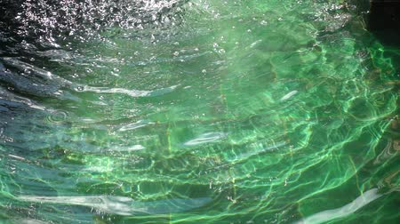 plash : Water ripples in the fountain. Slow motion.