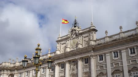 kraliçe : Royal Palace of Madrid. Spain. Flag over the palace and clouds.