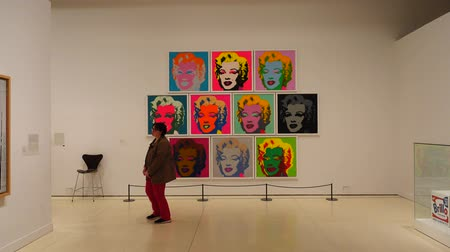 installation lectrique : MADRID, SPAIN - APRIL 05, 2018: Visitors in the CaixaForum Madrid view pictures at the exibition Andy Warhol Warhol. Mechanical Art. Stock Footage