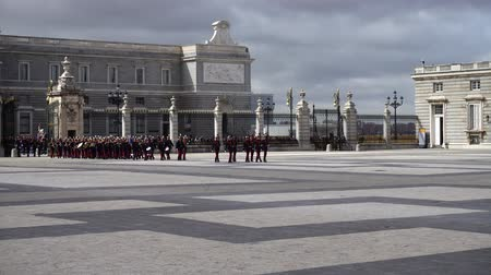 procession : MADRID, SPAIN - APRIL 04, 2018: The ceremony of the Solemn Changing of the Guard at the Royal Palace of Madrid. That is famous event was performed on the first Wednesday of each month.