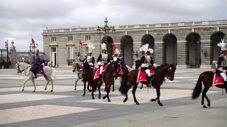 troop : MADRID, SPAIN - APRIL 04, 2018: The ceremony of the Solemn Changing of the Guard at the Royal Palace of Madrid. That is famous event was performed on the first Wednesday of each month.