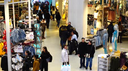 associated : MADRID, SPAIN - MARCH 25, 2018: Buyers in Primark Gran Via shop. The shop is the second largest outlet of the market in Manchester. Stock Footage