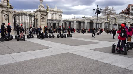 electro : MADRID, SPAIN - MARCH 27, 2018: Unknown tourists about the royal palace. The royal palace of the greatest of all the royal palaces of Europe.