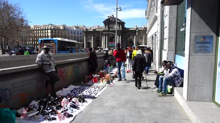 plaza independencia : MADRID, SPAIN - APRIL 3, 2018: Illegal trade on streets. The Puerta de Alcala. Alcala Gate is a Neo-classical monument in the Plaza de la Independencia.