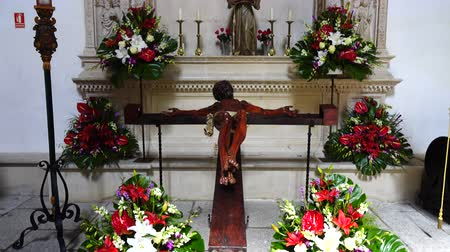 crucified : TOLEDO, SPAIN - MARCH 30, 2018: Interior of the Monastery of San Juan de los Reyes.