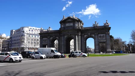 triumphal arch : MADRID, SPAIN - APRIL 3, 2018: The Puerta de Alcala. Alcala Gate is a Neo-classical monument in the Plaza de la Independencia.